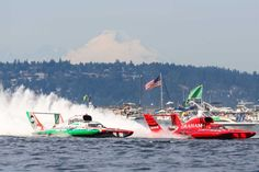 The U-1 Oberto and the U-5 Graham Trucking have a fierce battle for the lead in the championship race during Seafair 2015. Oberto was penalized during the race and the Graham Trucking boat won the race. Seafair, the traditional summer Seattle festival, brings hydroplane boats to Lake Washington and aircraft to the skies above for the weekend's Boeing Air Show. Photographed on Sunday, August 2, 2015