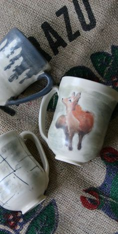 Created by Lone Fox Pottery     Large Mug, Red Fox Standing in Snow/Hunting in Winter Mug, Coffee Cup, unique hand made, hand thrown pottery, ceramics    Hand painted fox design, therefore each mug will be sightly different and unique. Created by drawing out the fox on the mug and then painting over the sketch. Finished with a warm matte glaze.    Ceramic Coffee Mug. Large Clay Mug. Coffee Cup. Hand made Mug. Stoneware Mug. Gift for Coffee Lover. Gift for Her. Gift for Him. Java Mug