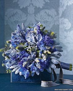 Dramatic Bouquet: Intense cerulean hydrangeas, delphiniums, and muscari are accented with hyacinth, sea holly, and pale-blue tweedia.