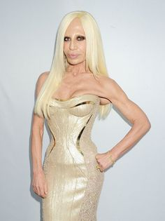 Donatella Versace - a fashion designer in a very poorly designed fashion. YIKES!!