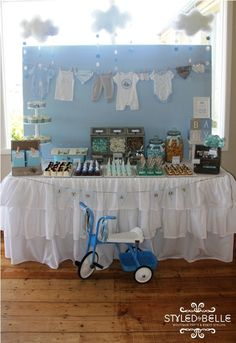 Oh Boy!! Create a table with a difference! Paint a piece of MDF or plywood, attach to the back of your table. Make a washing line using ribbon and peg all of those sweet newborn outfits!