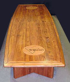Executive conference room table, by artist Neal Burns. African mahogany with logos. 509-466-4684