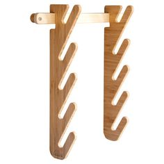 Artfully crafted from bamboo, this eye-catching skateboard rack doubles as coat hooks in the mushroom or entryway.  Product: Ska...