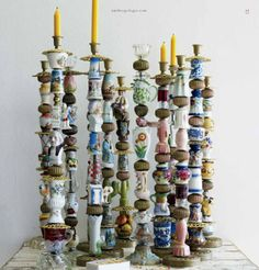 These eccentric candlesticks would be fun to DIY. Use a clustered arrangement for a centerpiece at your holiday dinners.