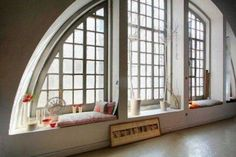 love the arched windows-- such character.. and always appreciate a window seat tucked in..