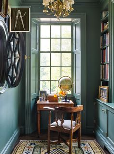 Nice detail in this cozy, practical library/reading nook. Love the full length shutters. Love the color.