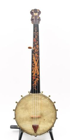 Impressive floral marquetry adorns this clean example from the Buckbee factory, including a quaint Butterfly on the peghead. Reproduction friction tuners, bridge, and tailpiece.  Skin head, nylgut setup.