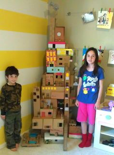 Rainy day project: The Box House  We started one last summer ... collect more boxes and go at it again.