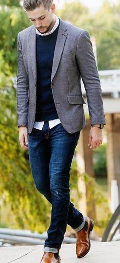 Blazer, sweater, button up shirt, dark wash denim and brow Chelsea boots.