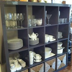 Ikea bookcase holds all the everyday plates and barware. Clever and clean looking.