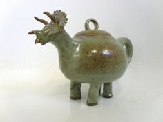 This is a teapot. And a dinosaur. I REALLY want one!!! So expensive though...
