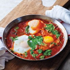 In Israel the word shakshuka is synonymous with breakfast. It's best with a slice or two of challah          bread to sop up the juices. This is a version of my dad's recipe, except that he used to mix the eggs together, because my older sister refused to eat the egg whites. Here is the recipe I prefer.