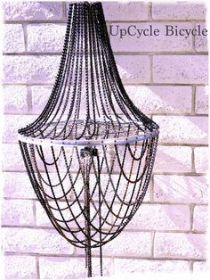 Just A DIRTY OLD CHANDELIER Vintage Chic Industrial Bike Chain Chandelier. $799.99, via Etsy.