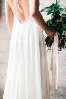 Low back lace-trimmed gown: http://www.stylemepretty.com/california-weddings/san-diego/2015/08/20/romantic-bridal-boudoir-inspiration-at-luce-loft/ | Photography: Whiskers & Willow - http://www.whiskersandwillow.com/