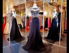 Delicate Details with Illusion High Neckline 115EC0150160389 BLACK / This magnificent black prom dress is full of delicate detailing on its Bodice cascading on the sides of the full length skirt. The illusion high neckline exudes an air of elegance and has a stunning cut out back for a glamorous feel. ONLY at Rsvp Prom and Pageant in Lawrenceville, Georgia or Buy it HERE at http://rsvppromandpageant.net/collections/long-gowns/products/115ec0150160389-black