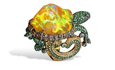 Lydia Courteille. Turtle ring with orange Mexican opal, orange sapphires, green garnets, yellow gold.