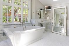 white marble bathroom 10 Affordable Ways to Make Your Home Look Like A Luxury Hotel