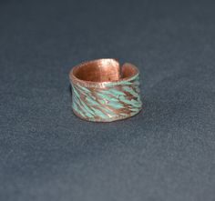 Check out this item in my Etsy shop https://www.etsy.com/listing/270049284/copper-ring-hammered-copper-engraved