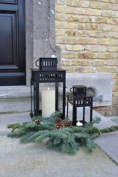 Ikea Borrby lanterns with evergreen boughs