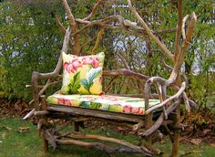 A whimsical driftwood bench with a bluestone seat.