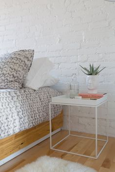 Bed custom by Simon Johns. Tray table from Danish brand HAY.
