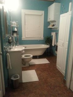 Teal, White and Silver bath room