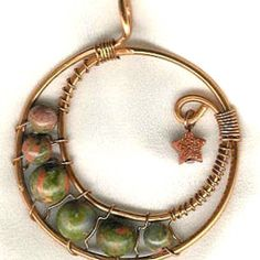 One of my pieces! This is called a Crescent Moon pendant, with Unakite (green) and Goldstone (star). Look for more of my jewelry at the Copper Wire Jewelry website, under Orion Lyonesse. #jewelrymaking