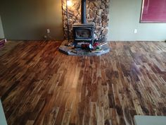 """We had carpet before, and everyone that comes to our house now just goes nuts about how much better our house looks that it did before."" Builder's Pride - Tobacco Road Acacia"