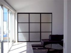 Closet Doors cat# 058 is shown in 1.5 inch frame black finish, trio design and frosted glass