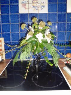 DIY Xmas Table Centrepiece. Tall stand/bit of oasis/whatever winter flowers and foliage from my garden