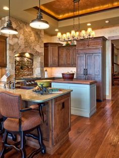 Designer Heather Guss used handcrafted stonework, hardwood floors and purposeful lighting to create this lodge-inspired kitchen. Interior Decorating Styles, Home Design Decor, Decorating Tips, Interior Design, Hardwood Floors In Kitchen, Kitchen Flooring, Wood Floor Finishes, Hickory Kitchen, Kitchen Corner