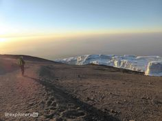 Making our way down with a superb view of the horizon and the Mount Kilimanjaro glacier