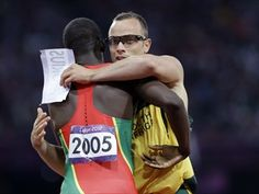 Kirani James and Oscar Pistorius trading name tags - one of the most touching & emotional images from this years Olympics.