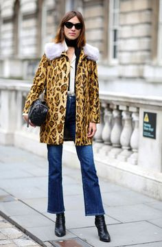 Alexa Chung wears kick flare denim and a leopard print coat.