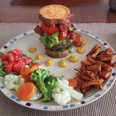 Paleo Avocado Bacon burger. 1 lbs grass feed beef seasoned with himalayian sea salt, pepper, minced garlic and onion. Topped with Applegate Farms bacon, sauteed red pepper and onion. Garnished with fresh guac (smash a ripe avocado And add lime juice and salt-n-pep to taste.) Add some shredded lettuce #yum Bun is mad of sweet potato. Slice Sweet potato to 1/2 inch slices and bake on each side 10 min at 350 on parchment paper lightly greased with coconut oil #BAM