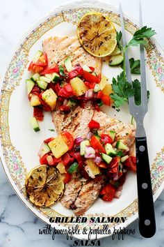 Grilled Salmon with Pineapple & Piquillo Peppers Salsa - A quick, fresh and extremely flavorful Pineapple & Piquillo Peppers Salsa served alongside grilled Salmon. Get the recipe on diethood.com