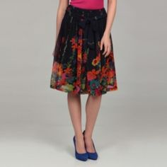 Colorful and stylish, a lovely floral pattern defines this navy skirt from Lola P. Fully lined, this pleated skirt is finished with a comfortable elastic waistline. $43.49