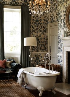 Clawfoot tub, floral wallpaper and antique chandeliers in a blue and white bathroom at Babington House hotel in Somerset, England Best hotels for family holidays in Britain UK breaks (Condé Nast Traveller) Home Interior, Bathroom Interior, Interior And Exterior, Interior Design, Interior Colors, Bad Inspiration, Bathroom Inspiration, Babington House, Bathroom Design Luxury