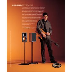 3 Doors Down guitarist Matt Roberts stands next to a pair of Reference Series speakers in a Klipsch advertisement. For more information on the Reference Series, go to http://www.klipsch.com/reference