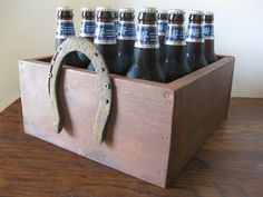 I LOVE the idea of horse shoe handles - maybe because I love wooden boxes like this.