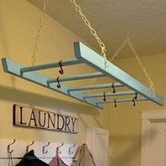 Laundry Ladder: Wondering what to do with that old wooden ladder? Give it a coat of paint in your favorite color and hang it from your ceiling to act as a drying rack, or cut it and mount it to the wall to create a drop-down drying rack.  Related:  5 Things to Do…With Vintage Ladders Photo: Indulgy