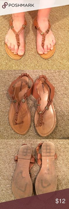 Tan sandals Tan sandals with gold detailing. Decent condition. Picture of bottoms included above. Loose fitting Wet Seal Shoes Sandals