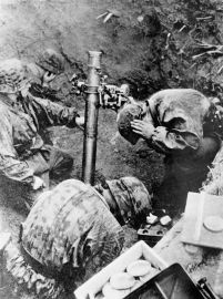 SS troops firing a 100mm Nebelwerfer 35. These smoke mortars could also fire high-explosive shells. The Germans became expert at concentrating mortar fire for maximum effect. The British called them 'stonks'. Pin by Paolo Marzioli
