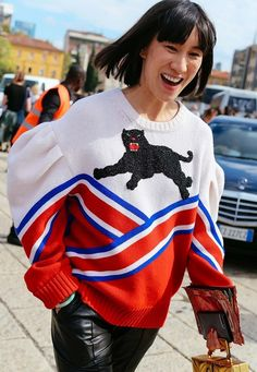 Eva Chen in a Gucci sweater spotted on the street at Milan Fashion Week. Photographed by Phil Oh.