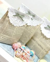 These are so cute you take newspaper and make them in to recycled lunch bags and then just for cutsie stuff and some lace ad a bow!