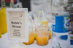 Create a cocktail in your honour. displayed in glass jars with straws -   Image by Chris Copeland Photography - An Irish DIY vintage wedding at santa's cottage with pastel colour scheme, home made wedding dress  and wedding photography by Chris Copeland