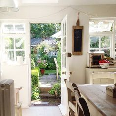 I like this kitchen that steps immediately into the back garden with a place for sitting.