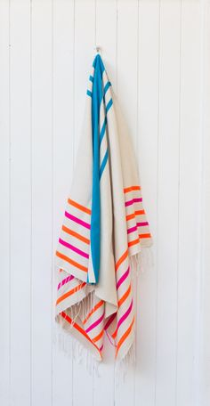 THE MARGARITA:  Our towels have been handwoven on traditional looms in Morocco. These stunning pieces are a blend of natural cotton and acrylic (in order to get the pops of neon!). Use them as a beach towel, sarong, picnic blanket, tablecloth or colour on the end of the bed or couch. They look great as towels in the bathroom OR use them as a cover over your pram. They are lightweight, absorbent and fast drying – perfect to roll up in your bag for your next outing.