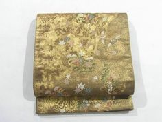 This is a gorgeous Fukuro obi with a design of phoenix, butterfly, kiku(chrysanthemum) and kaede(maple leaf), which is woven.