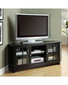 """TV in corner of bonus room when we get a sleeper sectional. Closer to cable outlet and makes for better sectional viewing! stand- corner? Kohls •27""""H x 60""""W x 18""""D •Holds most flat-screen TVs up to 72-in. wide"""